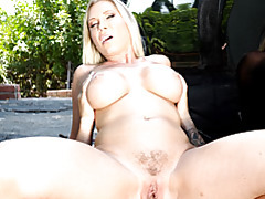 Busty babe bent over the car tubes
