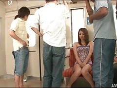 Group of guys undress and fondle japanese chick tubes