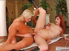 Redhead and blonde fucked in creampie video tubes