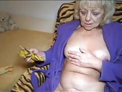 Granny in bathrobe masturbates after tea tubes