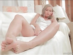 Beauty in soft white satin teases her feet tubes