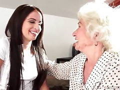 Young woman seduced by sexy granny tubes