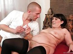 Mature slut margo masturbates in stockings tubes