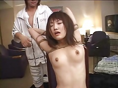 Japanese submissive in a cage groped in close up tubes