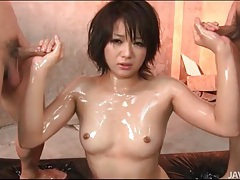 Beautiful japanese girl oiled up and sucking cock tubes
