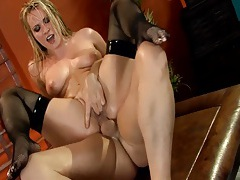 Slippery blonde fucked in fishnet thigh highs tubes