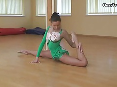 Leggy ballerina in leotard can bend her body tubes