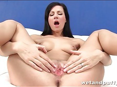 Young beauty rubs oil into her tight body tubes