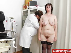 Spiky-looking housewife getting a gyno tubes