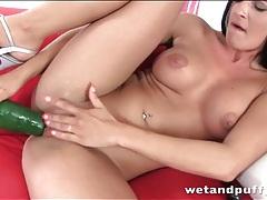Brunette masturbates both holes with big toys tubes