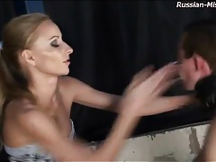 She slaps his face and spanks his ass tubes