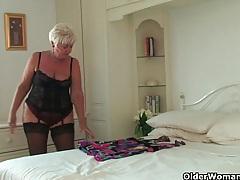 Chubby grandma in stockings rubs her pierced clit tubes