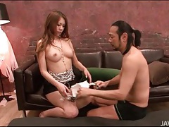 She rubs her feet all over his small cock tubes