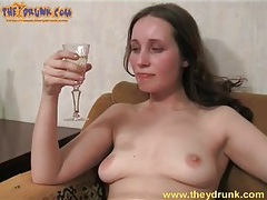 Champagne sipping girl masturbates her pussy tubes