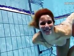 Naked teen looks lovely skinny dipping tubes