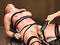 Tied girl gets deep dildo fucking tubes