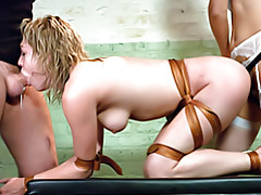 Strapon and blowjob in bondage tubes