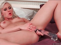 Masturbating blonde fucks big dildo tubes