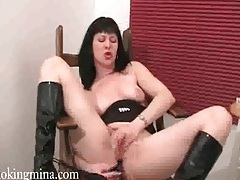 Smoking fetish girl in black latex boots tubes