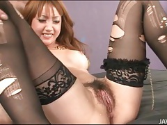 Toys fill this sexy chick in ripped stockings tubes