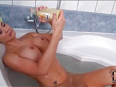 Fake titty jasmine jae masturbates in the tub tubes