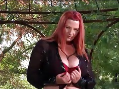 Curvy redhead in a slutty latex skirt tubes