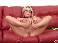 Milf in glasses fondles her fake titties tubes