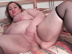 Chubby girl models her shaved pussy for us tubes