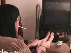 Smoking girl plays video games tubes