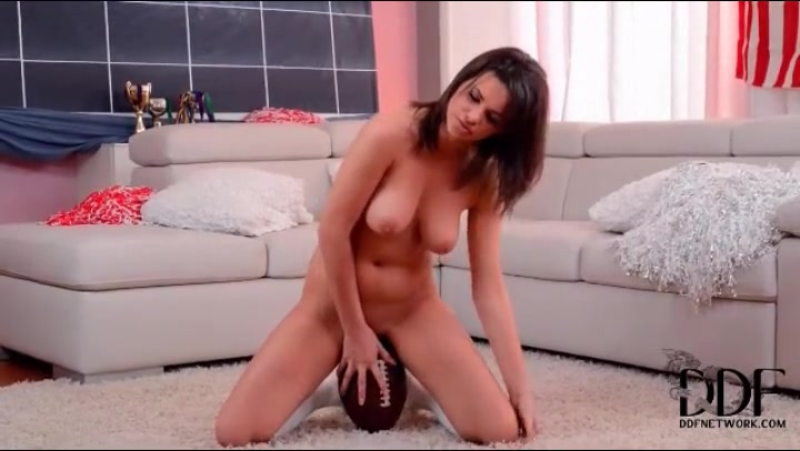 Curvy girl sits her hot pussy on a football tubes