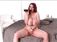 Curvy redhead fills pussy with a dildo tubes