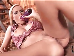 Blonde babe in the hay fucks her dildo tubes