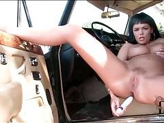 Curvy girl anally masturbates on the car tubes