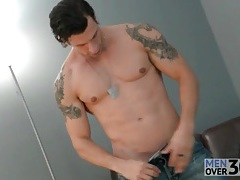 Gorgeous shaved guy strips and strokes tubes