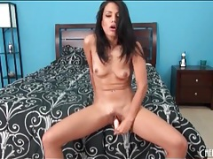 Dildo slowly slides into shaved brunette pussy tubes