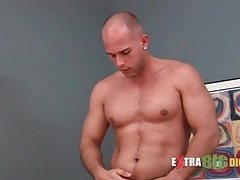 Sexy muscular guy strips to his underwear tubes