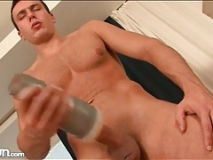 Guy with great pecs masturbates and cums tubes