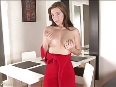 Sexy big tits brunette strips from red dress tubes