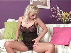 Blonde in lingerie gets naked and fingers pussy tubes