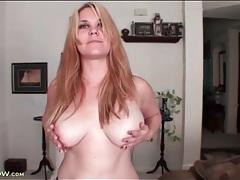 Cute busty blonde in a solo striptease tubes
