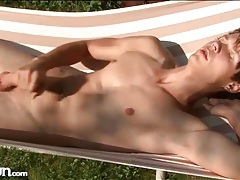 Naked guy masturbates in a hammock tubes