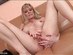 Round fake titties on masturbating blonde milf tubes