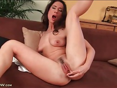 Shiny dildo up the butt of a milf brunette tubes