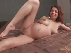 Naked pregnant babe masturbates in bed tubes