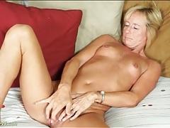 Skinny blonde mature masturbates her cunt tubes