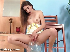 Big glass bowl takes piss of a cute brunette tubes