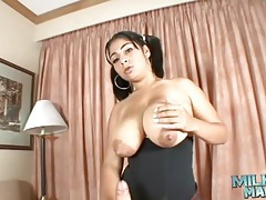Milky tits girl in pigtails gives a titjob tubes