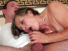 Moaning mature sits on his young cock tubes