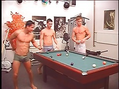 Topless guys play pool and strip naked tubes