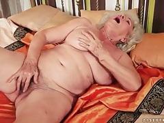 Solo granny masturbates her hairy cunt tubes